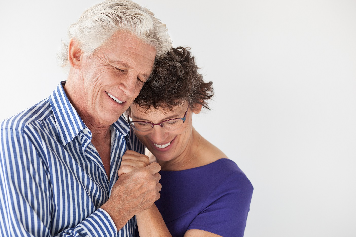 Affectionate senior couple embracing and dancing